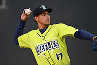 Catcher Juan Uriarte (17) of the Columbia Fireflies warms up before a game against the Charleston RiverDogs on Thursday, April 4, 2019, at Segra Park in Columbia, South Carolina. Charleston won, 2-1. (Tom Priddy/Four Seam Images)