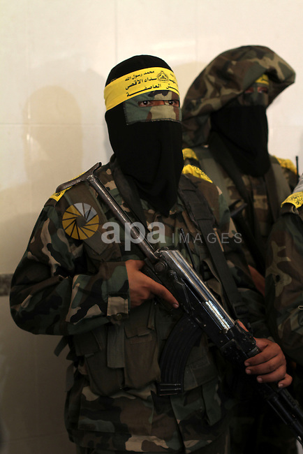 Palestinian militants of al-Aqsa Brigades, the armed wing of Fatah movement, hold a press conference during a rally marking the 13th anniversary of Al-Aqsa Intifada in the Central Gaza Strip on Sep. 26, 2013. Photo by Ashraf Amra