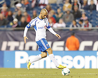 Montreal Impact forward Marco Di Vaio (9) collects a pass.  In a Major League Soccer (MLS) match, Montreal Impact (white/blue) defeated the New England Revolution (dark blue), 4-2, at Gillette Stadium on September 8, 2013.