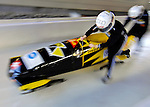 14 December 2006: Sabina Hafner, team pilot from Switzerland, pushes her sled at the start of a training run in preparation for the World Cup Bobsleigh Competition at the Olympic Sports Complex on Mount Van Hoevenburg  in Lake Placid, New York, USA.&amp;#xA;&amp;#xA;Mandatory Photo credit: Ed Wolfstein Photo<br />
