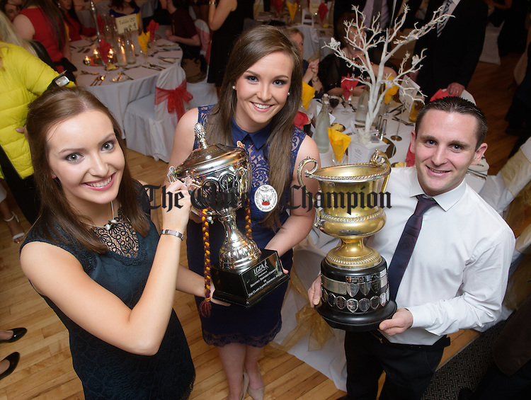 Joint lady captains Katie Curtin and Siobhan Talty with mens captain Brian Curtin at the St Joseph's GAA victory celebrations in the Armada Hotel for their Senior mens and Ladies football teams. Photograph by John Kelly.