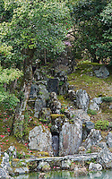 The 'dry waterfall' on the shore of the lake in the 14th century gardens of the Tenryu-ji Temple, Kyoto