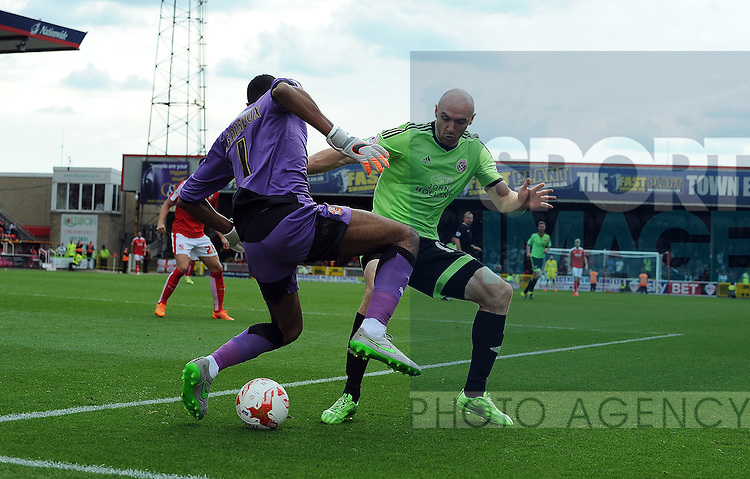 Conor Sammon of Sheffield United is challenged by Swindon Town goalkeeper Lawrence Vigouroux<br /> - English League One - Swindon Town vs Sheffield Utd - County Ground Stadium - Swindon - England - 29th August 2015 <br /> --------------------