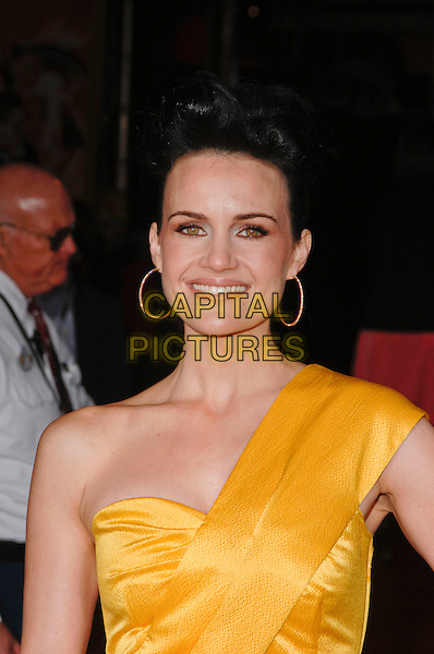 "CARLA GUGINO.World premiere of ""Race to Witch Mountain, El Capitan Theatre, Hollywood, California, USA,.March 11th 2009..portrait headshot gold hoop earrings yellow one shoulder  .CAP/ROT.©Lee Roth/Roth Stock/Capital Pictures."