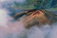 Pu'u O Maui cinder cone in the crater at HALEAKALA NATIONAL PARK on Maui in Hawaii is shrouded by a necklace of clouds