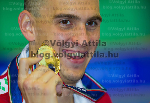 Laszlo Cseh of Hungary celebrates his victory in the Men's 200m Butterfly of the 31th European Swimming Championships in Debrecen, Hungary on May 23, 2012. ATTILA VOLGYI