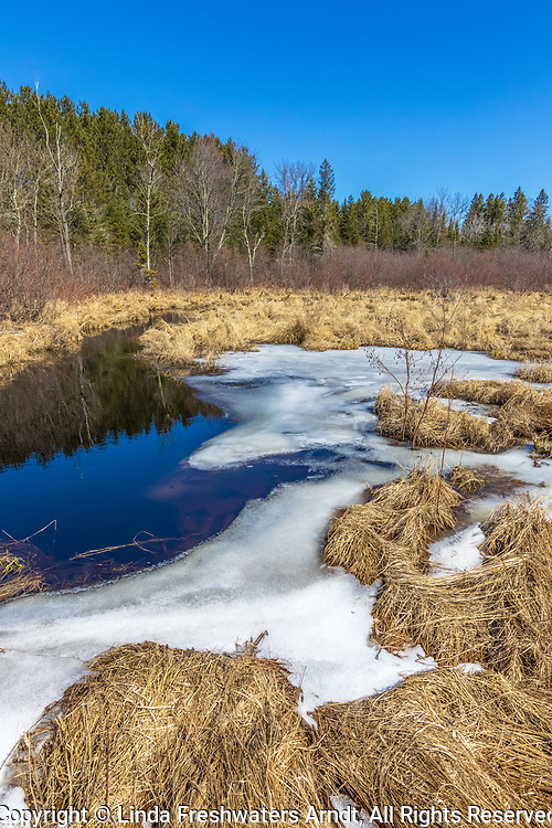 The seasonal transition from winter to spring in northern Wisconsin.