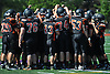 Babylon teammates gather together before the start of a Suffolk County Division IV varsity football game against Mount Sinai at Islip High School on Saturday, September 5, 2015.<br /> <br /> James Escher