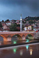The Seher-Cehaja Bridge at night, a 16th century Ottoman bridge crossing the Miljacka river, and the minaret of the Hadzijska Mosque or Vekil Harc Mosque, built 1541-61, Sarajevo, Bosnia and Herzegovina. The city was founded by the Ottomans in 1461. Picture by Manuel Cohen