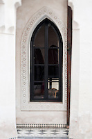Glimpse of the ornately carved plasterwork surround to one of the Riad Dar Darma's windows