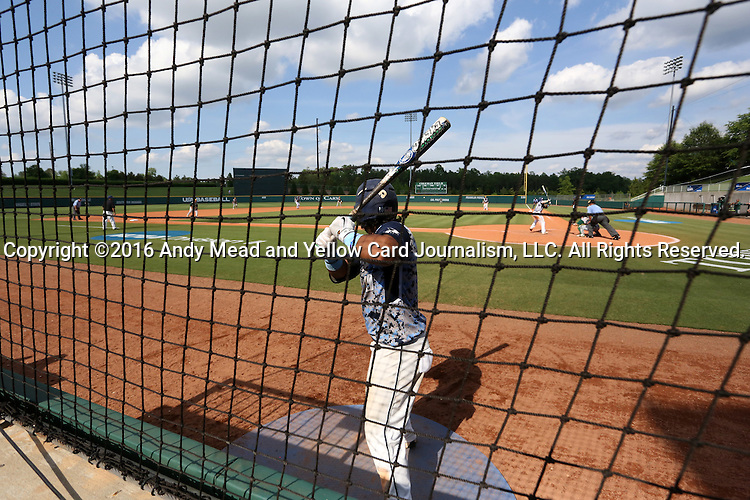 02 June 2016: Nova Southeastern's Andres Visbal waits in the on deck circle. The Nova Southeastern University Sharks played the Cal Poly Pomona Broncos in Game 11 of the 2016 NCAA Division II College World Series  at Coleman Field at the USA Baseball National Training Complex in Cary, North Carolina. Nova Southeastern won the semifinal game 4-1 and advanced to the championship series.