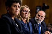UNITED STATES - SEPTEMBER 27: Christine Blasey Ford, center, flanked by attorneys Debra Katz (L) and Michael Bromwich, testifies during the Senate Judiciary Committee hearing on the nomination of Brett M. Kavanaugh to be an associate justice of the Supreme Court of the United States, focusing on allegations of sexual assault by Kavanaugh against Christine Blasey Ford in the early 1980s. (Photo By Tom Williams/CQ Roll Call/POOL)