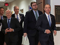 United States Representative Adam Schiff, Chairman, US House Permanent Select Committee on Intelligence, right, leads other members and staff as they depart the hearing area for a vote as Michael Cohen, Former attorney to United States President Donald J. Trump, gives testimony in a closed hearing before the before the committee on Capitol Hill in Washington, DC on Wednesday, March 6, 2019. Photo Credit: Ron Sachs/CNP/AdMedia