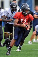 7 August 2011:  FIU's Akil Dan-Fodio (11) scrambles with the ball during the first day of fall practice with full pads at University Park Stadium in Miami, Florida.