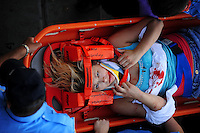 Apr 26, 2009; Talladega, AL, USA; (Editors Note: graphic content) A NASCAR Sprint Cup Series fan is carried out of the grandstands by medics after being injured from debris from a last lap crash during the Aarons 499 at Talladega Superspeedway. Mandatory Credit: Mark J. Rebilas-