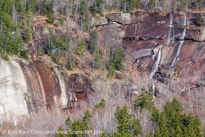 Spring snow melt and heavy rains drain down a cliff along the Kancamagus Highway in the White Mountains, New Hampshire USA