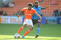 Blackpool's Grant Ward under pressure from Swindon Town's Anthony Grant<br /> <br /> Photographer Kevin Barnes/CameraSport<br /> <br /> The EFL Sky Bet League One - Blackpool v Swindon Town - Saturday 19th September 2020 - Bloomfield Road - Blackpool<br /> <br /> World Copyright © 2020 CameraSport. All rights reserved. 43 Linden Ave. Countesthorpe. Leicester. England. LE8 5PG - Tel: +44 (0) 116 277 4147 - admin@camerasport.com - www.camerasport.com