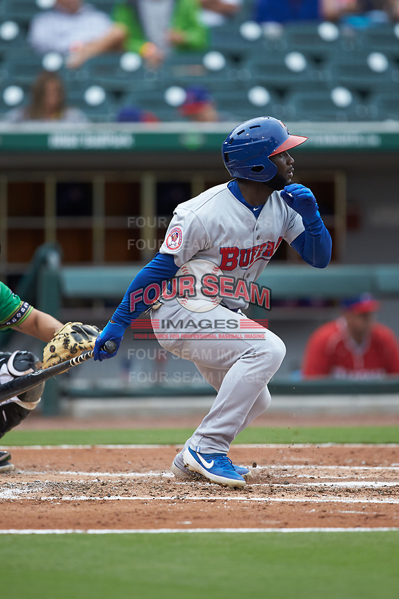 Roemon Fields (4) of the Buffalo Bisons follows through on his swing against the Caballeros de Charlotte at BB&T BallPark on July 23, 2019 in Charlotte, North Carolina. The Bisons defeated the Caballeros 8-1. (Brian Westerholt/Four Seam Images)