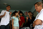 UNICEF Goodwill Ambassador, Greig Pickhaver, jokes with staff and children at the UNICEF-supported drop-in centre.<br /> <br /> Many of these children are living on the streets after running away from broken and abusive homes. As well as HIV advice and skills training, the centre helps with medical treatment and works to get them into school or safe employment.<br /> <br /> In May 2007, Qantas staff from the Change for Good programme visited UNICEF in northern Thailand to see how money they have raised is helping children.