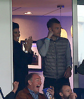 The suspended Jamie Vardy of Leicester City celebrates with his fiancee Rebekah Nicholson as Riyad Mahrez scores a goal to make the score 1-0 during the Barclays Premier League match between Leicester City and Swansea City played at The King Power Stadium, Leicester on 24th April 2016