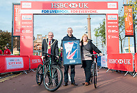Picture by Allan McKenzie/SWpix.com - 24/09/2017 - Cycling - HSBC UK City Ride Liverpool - Albert Dock, Liverpool, England - Rob Pickering presents the Lord Mayor of Liverpool Malcolm Kennedy and Assistant Mayor of Liverpool Wendy Simon with the Partnership Jersey.