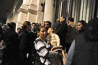 """Roma 23 Aprile 2011.I Rom romeni sgomberati dal campo di via dei Cluniacensi in zona Tiburtina,occupano la Basilica di San Paolo.Donne, bambini  e uomini fuori dalla Basilica, sotto la pioggia.La gendarmeria vaticana non lascia entrare i Rom nella chiesa la notte di Pasqua,.Alcune famiglie trovano rifugio nella vivìcina sede della """"Comunità cristiana di base San Paolo """" in via Ostiense Rome April 23, 2011.The Roma evicted from the camp, of street of the Cluniacensi, near Tiburtina, occupy the Basilica di San Paolo.Pending the negotiations with the City of Rome, to find a solution accommodation.."""
