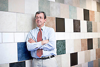 TROSA's In-kind department manager, Greg Finn, demonstates the benefits of in-kind donations. This tile mosaic wall was donated to TROSA.