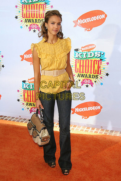 JESSICA ALBA.Nickelodeon's 19th Annual Kids' Choice Awards held at Pauley Pavilion, Westwood, California, USA.  .April 1st, 2006.Photo: Zach Lipp/AdMedia/Capital Pictures.Ref: ZL/ADM.full length jeans denim yellow ruffles belt bag purse.www.capitalpictures.com.sales@capitalpictures.com.© Capital Pictures.