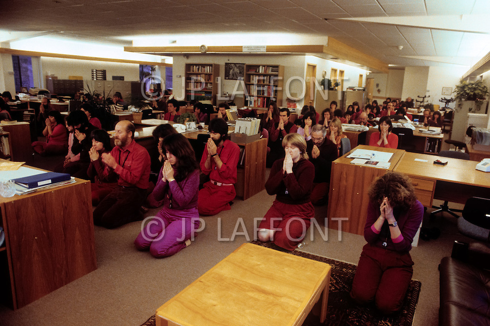 Wasco, Oregon, January 1984:  Disciples of Bhagwan Rajneesh in a group mediation session. Rajneeshpuram, was an intentional community in Wasco County, Oregon, briefly incorporated as a city in the 1980s, which was populated with followers of the spiritual teacher Osho, then known as Bhagwan Shree Rajneesh. The community was developed by turning a ranch from an empty rural property into a city complete with typical urban infrastructure, with population of about 7000 followers.