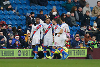 30th November 2019; Turf Moor, Burnley, Lanchashire, England; English Premier League Football, Burnley versus Crystal Palace; Wilfried Zaha of Crystal Palace celebrates with his team mates after putting his team 1-0 ahead in added time of the first half - Strictly Editorial Use Only. No use with unauthorized audio, video, data, fixture lists, club/league logos or 'live' services. Online in-match use limited to 120 images, no video emulation. No use in betting, games or single club/league/player publications