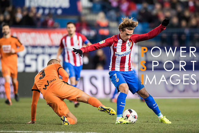 Antoine Griezmann (r) of Atletico de Madrid battles for the ball with Alejandro Galvez Jimena of SD Eibar during their Copa del Rey 2016-17 Quarter-final match between Atletico de Madrid and SD Eibar at the Vicente Calderón Stadium on 19 January 2017 in Madrid, Spain. Photo by Diego Gonzalez Souto / Power Sport Images