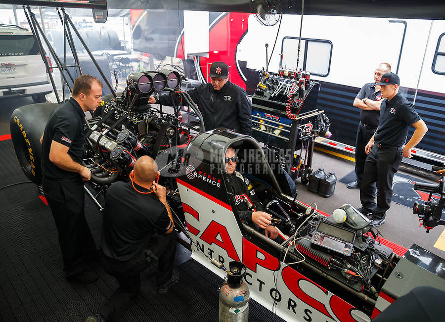 Feb 10, 2017; Pomona, CA, USA; Crew members surround the car of NHRA top fuel driver Steve Torrence as he warms up in the pits during qualifying for the Winternationals at Auto Club Raceway at Pomona. Mandatory Credit: Mark J. Rebilas-USA TODAY Sports