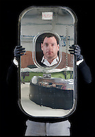 BNPS.co.uk (01202 558833)<br /> Pic: PhilYeomans/BNPS<br /> <br /> Bespoke furniture for the Jet Set.<br /> <br /> Brett Armstrong with a mirror polished escape hatch from an old passenger jet - yours for &pound;995 + VAT<br /> <br /> Two brother's have come up with ultimate in aircraft recycling - turning unwanted bits of redundant airliners into highly desirable - and highly expensive - bespoke items of furniture.<br /> <br /> Brett and Shane Armstrong from Kent scour the worlds aircraft graveyards looking for interesting items they can rescue from sad decay and with a lot of imagination and elbow grease convert into one-off gleaming items of furniture costing thousands of pounds.