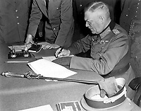 Field Marshall Wilhelm Keitel, signing the ratified surrender terms for the German Army at Russian Headquarters in Berlin, Germany, May 7, 1945.  Lt. Moore. (Army)<br /> NARA FILE #:  111-SC-206292<br /> WAR & CONFLICT BOOK #:  1353