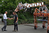 United States President Barack Obama (L) shakes hands with Lindsay Lawlor of San Diego, California, the builder of a robotic giraffe at the White House Maker Faire projects on the South Lawn, June 18, 2014, in Washington, DC. The Faire is a series of projects by students,  entrepreneurs and regular citizens using new technologies and tools to launch new businesses and learning new skills in science, technology, engineering and mathematics.     <br /> Credit: Mike Theiler / Pool via CNP
