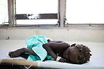 A young cholera patient sleeps on a cot at the Hospital Albert Schweitzer on Thursday, October 28, 2010 in Deschapelles, Haiti.
