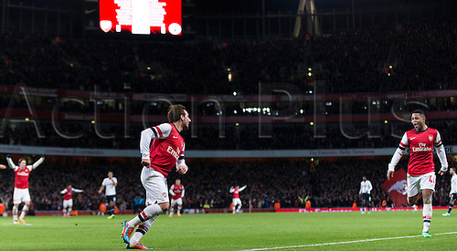04.01.2014 London, England.  Arsenal midfielder Santi CAZORLA celebrates his goal during the FA Cup 3rd Round game between Arsenal and Tottenham Hotspur from the Emirates Stadium.