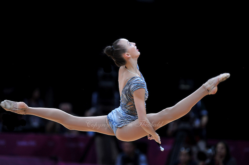 August 10, 2012; London, Great Britain;  ANNA RIZATDINOVA of Ukraine split leaps with clubs on day 2 of rhythmic gymnastics qualifying at London 2012 Olympics.