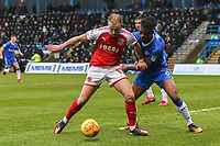 Paddy Madden of Fleetwood Town holds off Gabriel Zakuani of Gillingham during the Sky Bet League 1 match between Gillingham and Fleetwood Town at the MEMS Priestfield Stadium, Gillingham, England on 27 January 2018. Photo by David Horn.