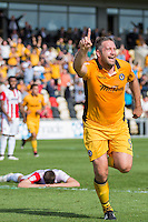 Jonathan Parkin of Newport County celebrates scoring his side's second goal during the Sky Bet League 2 match between Newport County and Cheltenham Town at Rodney Parade, Newport, Wales on 10 September 2016. Photo by Mark  Hawkins / PRiME Media Images.