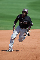 Mississippi State Bulldog outfielder Demarcus Henderson #2 sprints to third base during the NCAA baseball game against the LSU Tigers on March 18, 2012 at Alex Box Stadium in Baton Rouge, Louisiana. LSU defeated Mississippi State 4-2. (Andrew Woolley / Four Seam Images).