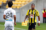 Phoenix's Kenny Cunningham, right, stares down Perth Glory's Matthew Davies, left, after an altercation in the A-League football match at Westpac Stadium, Wellington, New Zealand, Sunday, March 09, 2014. Credit: Dean Pemberton