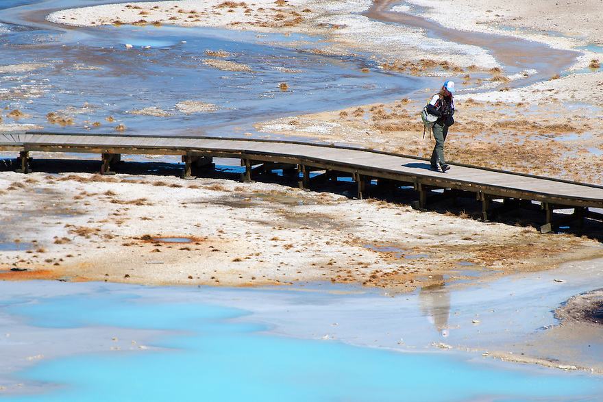 A visitor explores Norris Gesyer Basin in Yellowstone National Park.