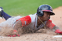 Ozzie Albies (2) of the Gwinnett Braves slides head-first across home plate to score a run against the Charlotte Knights at BB&T BallPark on May 22, 2016 in Charlotte, North Carolina.  The Knights defeated the Braves 9-8 in 11 innings.  (Brian Westerholt/Four Seam Images)