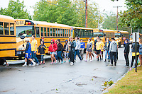 Salve Regina freshmen board busses as they take part in the Exploration Day of Service on Aquidneck Island.