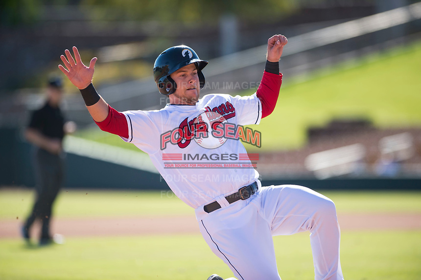 Glendale Desert Dogs right fielder Connor Marabell (4), of the Cleveland Indians organization, slides into third base during an Arizona Fall League game against the Mesa Solar Sox at Camelback Ranch on November 12, 2018 in Glendale, Arizona. Glendale defeated Mesa 4-2. (Zachary Lucy/Four Seam Images)