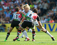 Richie Gray of Sale Sharks is tackled by Nick Evans (left) and Tom Guest of Harlequins during the Aviva Premiership match between Harlequins and Sale Sharks at The Twickenham Stoop on Saturday 15th September 2012 (Photo by Rob Munro)
