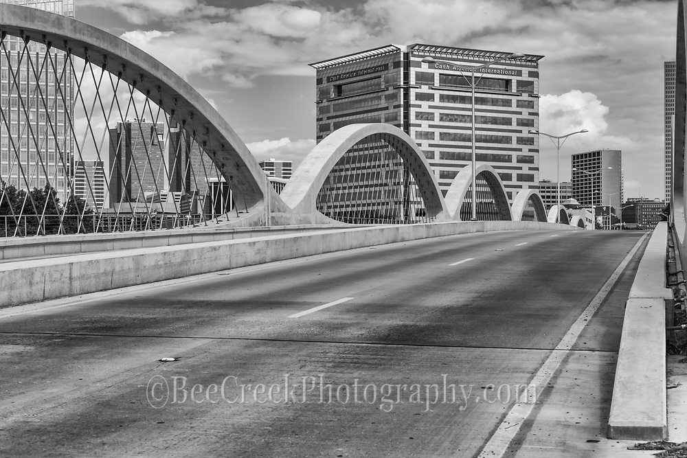 This is a black and white of the 7th street bridge as it flows into the downtown Fort Worth.