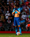 Arsenal's Mesut Ozil reacts after Liverpool's third goal during the premier league match at Anfield Stadium, Liverpool. Picture date 27th August 2017. Picture credit should read: Paul Thomas/Sportimage