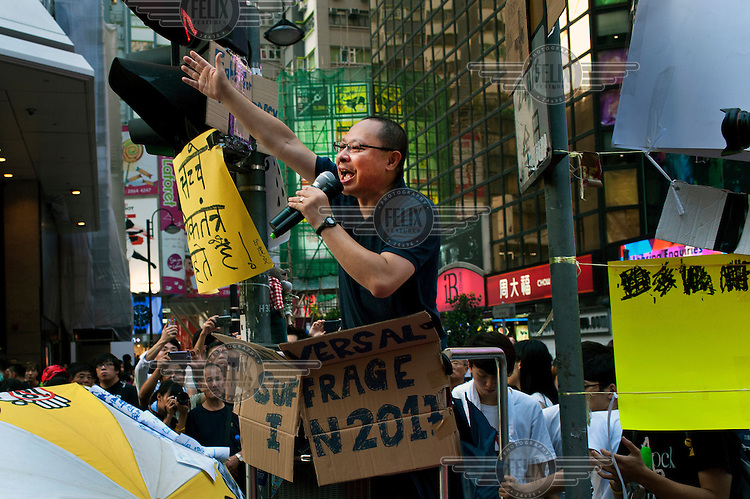 Benny Tai talking to students gathered in Causeway Bay as part of the 'Occupy Central ' movement which is organising events of civil disobedience to protest against the Chinese government's electoral policy for Hong Kong. Hong Kong was supposed to be having direct elections for the post of chief executive by 2017 but the government in Beijing has said that the election will only be from a list of pre-approved candidates. Benny Tai Yiu-ting, Associate Professor of Law at the University of Hong Kong, is the founder of Occupy Central with Love and Peace (OCLP), often abbreviated to Occupy Central.